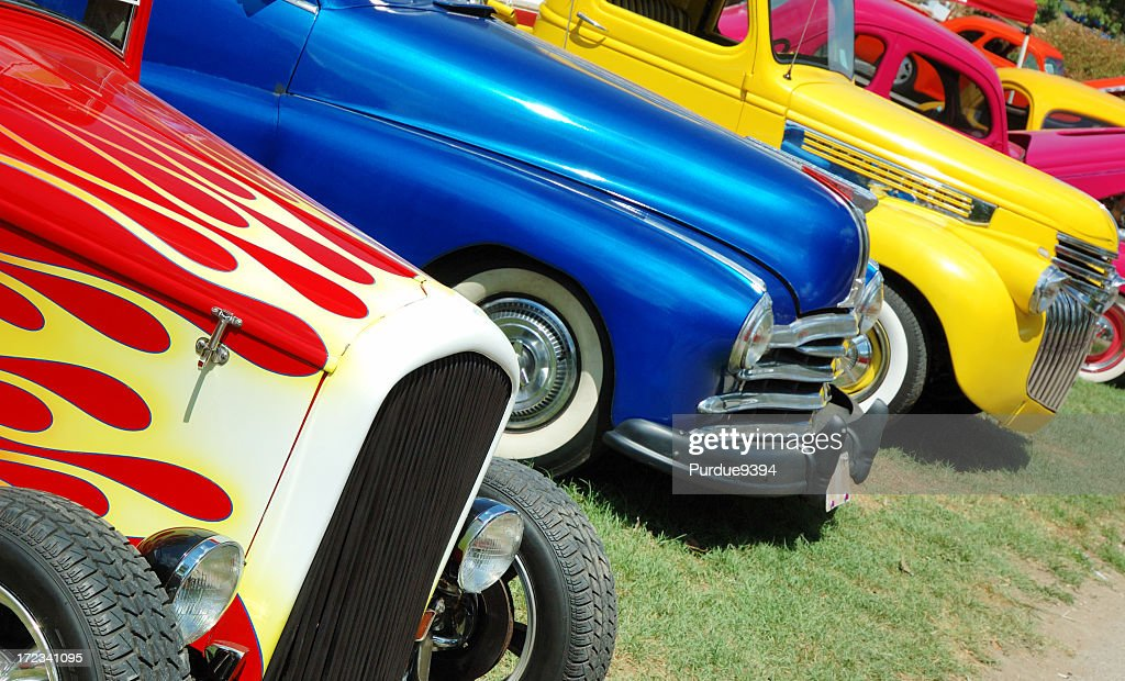 Line of hotrod cars in grass at car show : Stock Photo