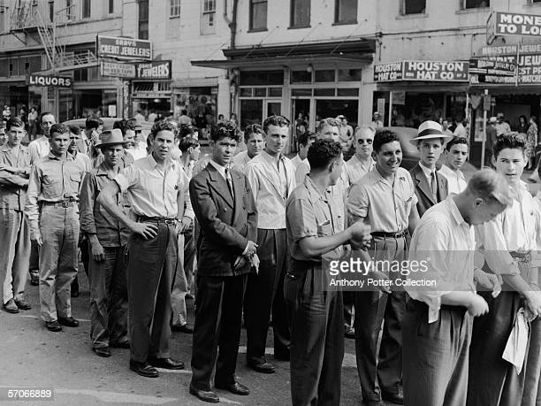 Line of inducted men on their way to a military reception center, Houston, Texas, May 1943.