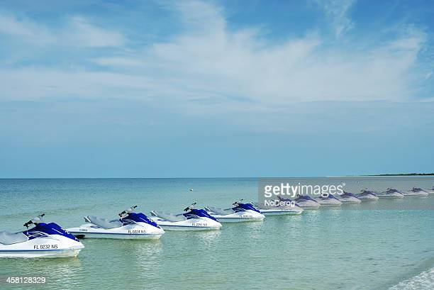 line of jetskis off beach at marco island - marco island stock pictures, royalty-free photos & images