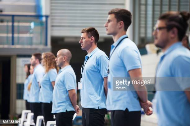 line of judges at a swimming tournament - sports official stock pictures, royalty-free photos & images