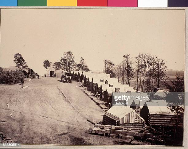 A line of log cabins marks the winter barracks of the 1st Connecticut Heavy Artillery 1864