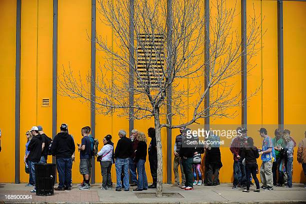 A line of marijuana enthusiasts wraps around the block as they wait to get in during the final day of the first ever High Times US Cannabis Cup at...