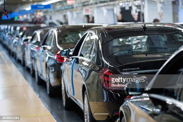 A line of MercedesBenz Maybach luxury automobiles stand on the final quality check line at the automaker's factory in Sindelfingen Germany on...