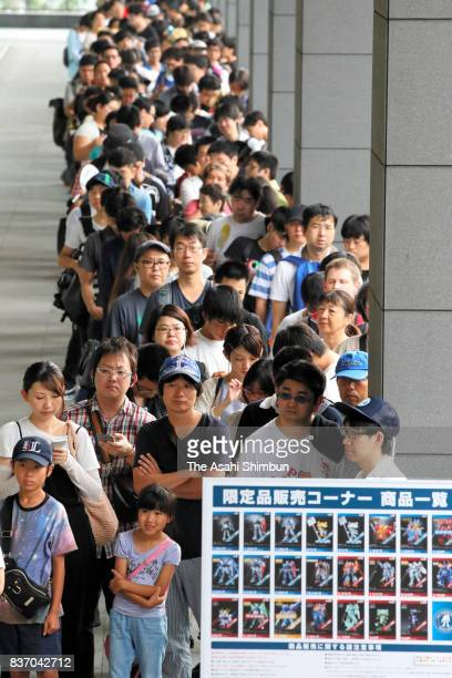 A line of more than 300 people forms two hours before the opening of Gundam Base Tokyo on August 19 2017 in Tokyo Japan Gundam mania swooped into the...