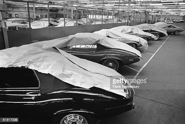 A line of new Jaguar Etype sports cars under dust sheets at the Jaguar factory Coventry 2nd September 1972