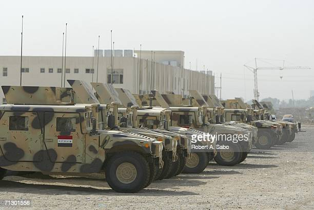 A line of newly acquired for the Iraqi Army Humvees are seen at Muthenna Airfield June 20 2006 in central Baghdad Iraq When a number of Iraqi...
