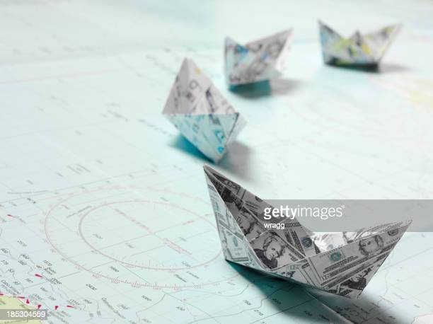 Line of Origami Boats in Currency