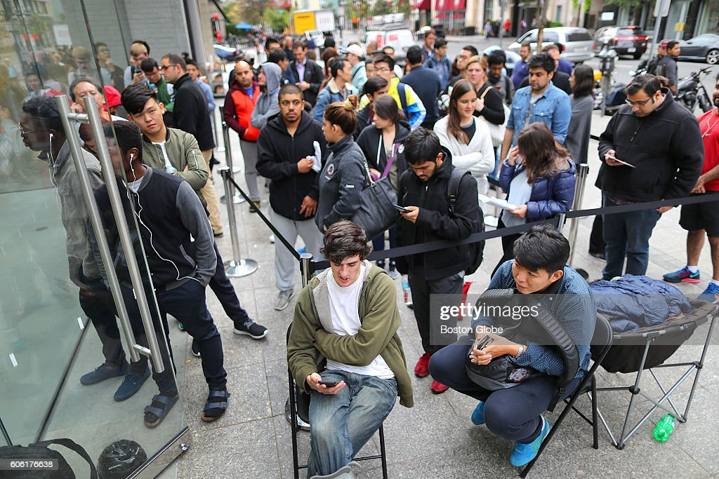 A Line Of Over Hundred People Wait In To Be The First Person
