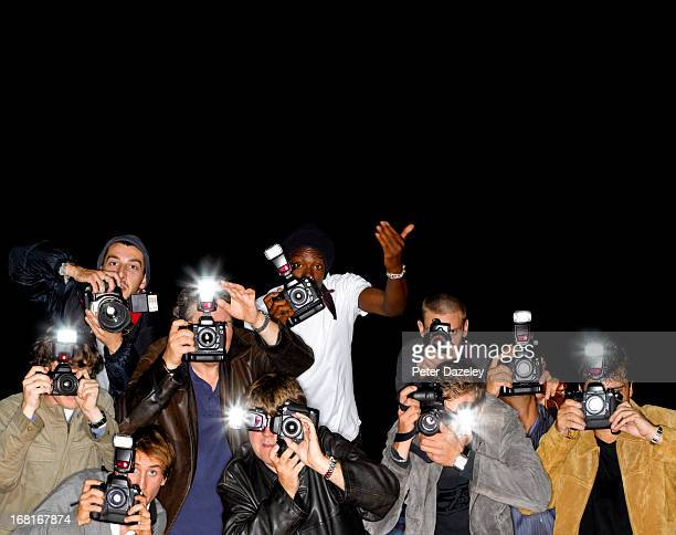 Line of paparazzi photographers with copy space