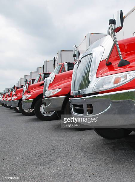 Line of parked red and shiny trucks