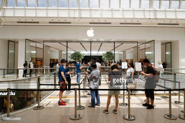 Line of people are seen outside the Apple store in Chadstone Shopping Centre on November 19, 2020 in Melbourne, Australia. Victoria has recorded 20...
