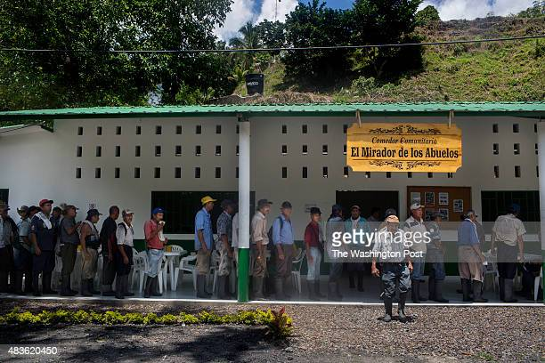 A line of people line up at the community eatery El Mirador de los Abuelos for lunch in the municipality of Muzo department of Boyacá Colombia on...