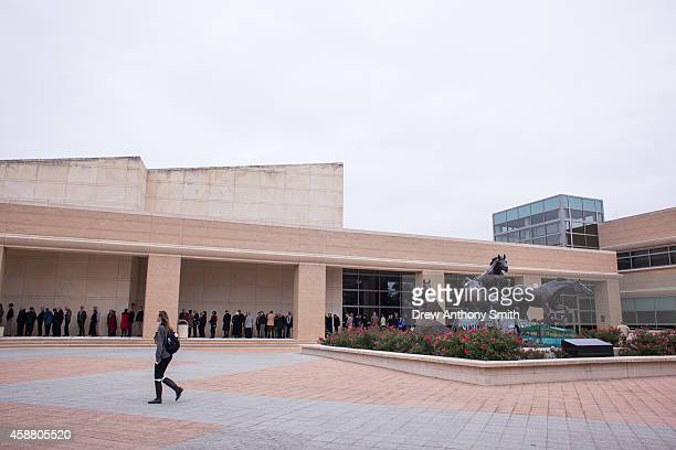 A line of people wait for former US President George W Bush to give a talk about his book '41 A Portrait of My Father' in the George Bush...
