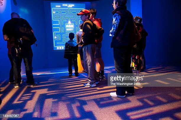 A line of people wait to play PacMan at the exhibit The Art of Video Games is an exhibit at the American Art Museum thru September 30 2012