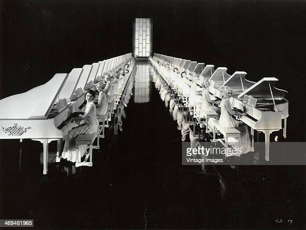 Line of pianists in a musical interlude from the Busby Berkeley film 'Gold Diggers of 1935', 1935.