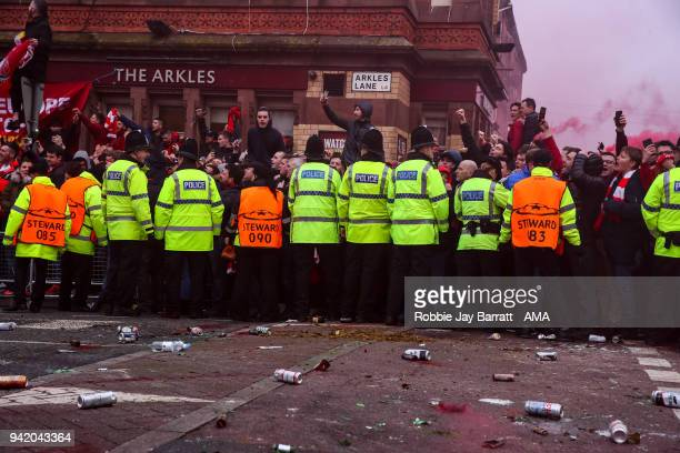 A line of Police and stewards hold back fans of Liverpool prior to the UEFA Champions League Quarter Final first leg match between Liverpool and...