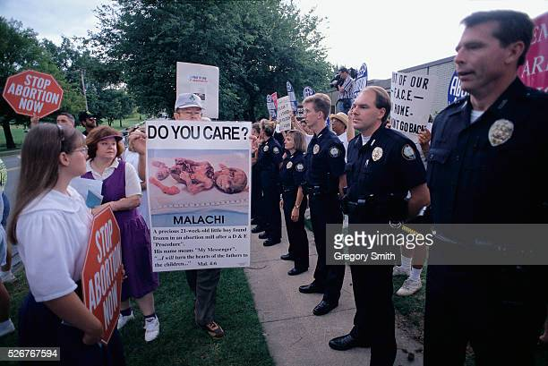 A line of police officers separates prolife and prochoice demonstrators outside of a pregnancy clinic in Little Rock Arkansas The antiabortion...