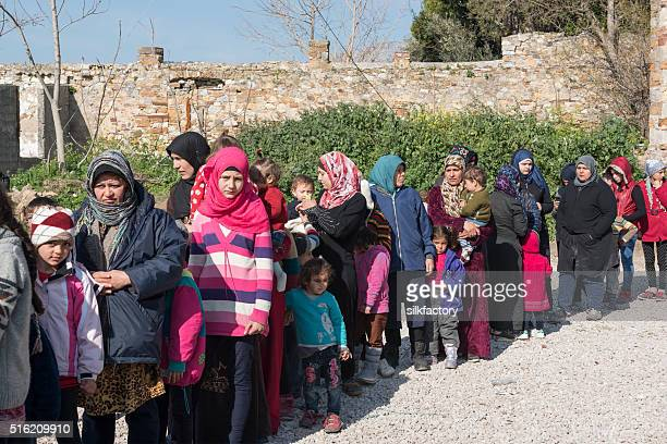 line of refugees at chios waiting for food - refugee camp stock pictures, royalty-free photos & images