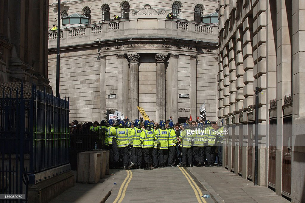 A line of riot police holding back protestors in London the day before a G20 meeting, Bank, in the City of London 1st April 2009.