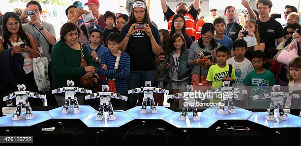 A line of Robotis Dynamixal Mini robots dance to music at the Defense Advanced Research Projects Agency Robotics Challenge Expo at the Fairplex June...