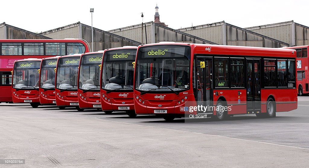 A line of single-decker Abellio London buses are parked in Battersea Bus Depot on May 17, 2010 in London, England. New Routemaster double-decker buses, will feature a rear open platform enabling people to 'hop-on hop-off', are claimed to be 40% more fuel efficient than current London buses and are due to go into service in 2011.