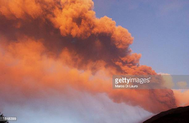 A line of smoke spreads across the sky above the Mount Etna October 29 2002 in Sicily Italy Mount Etna Europe's largest and most active volcano...