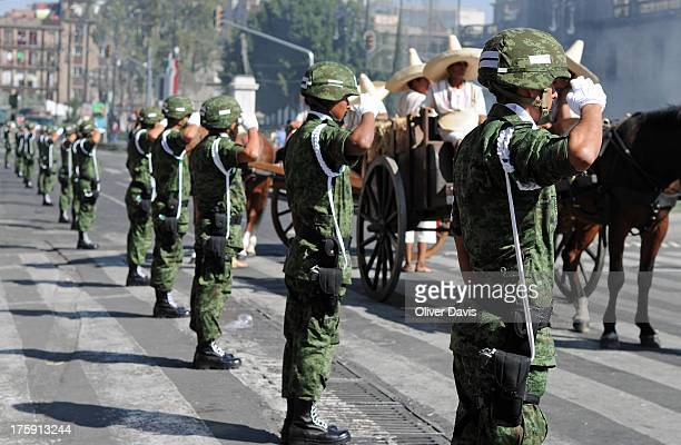 CONTENT] Line of soldiers in military uniforms saluting during Mexican Revolution Day parade Mexico City Celebrations to mark the anniversary of the...