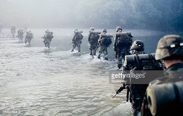 Line of soldiers marching through water