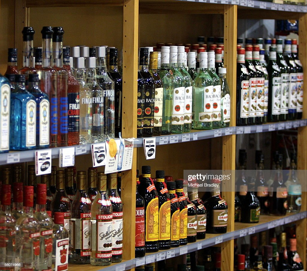 A line of spirits bottles at a local alcohol shop.