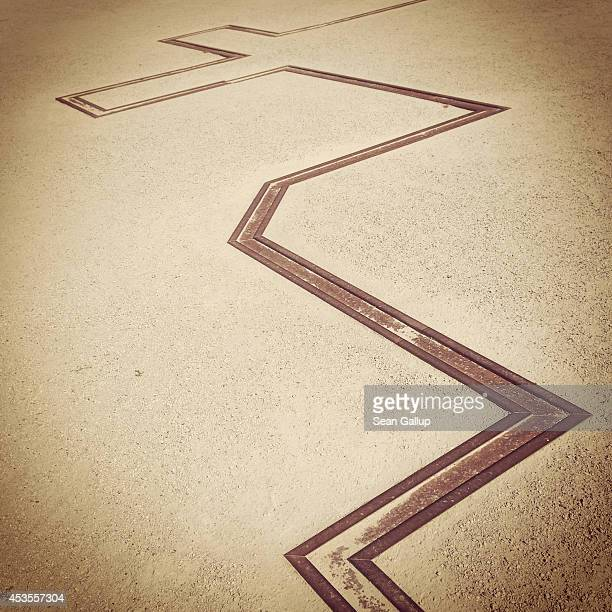 A line of steel shows the contours of where the Church of Reconciliation demolished by East German authorities to make way for the Berlin Wall once...