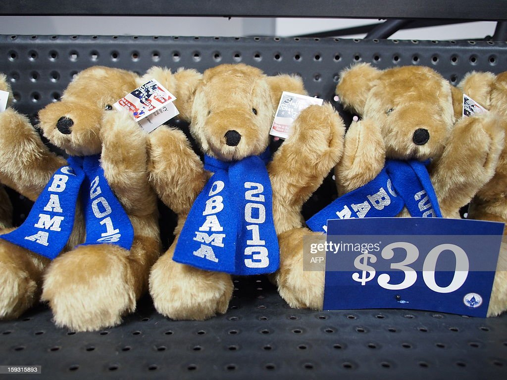 A line of teddy bears with US President Barack Obama sashes sit on a shelf at the opening of the Official Inaugural Store in Washington on January 11, 2013. The downtown boutique offers a selection of buttons, T-shirts, glassware, medallions and other commemorative items to mark the January 21 public inauguration of Obama's second term in the White House. AFP PHOTO/Robert MacPherson