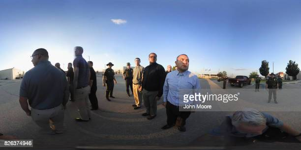 A line of trainees are watched by Border Patrol agents upon their initial arrival to the US Border Patrol Academy on August 2 2017 in Artesia New...