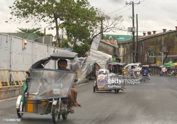 A line of tricycles seen in the main street in Baseco Compound The Batangas Shipping and Engineering Company Compound is the largest among five...