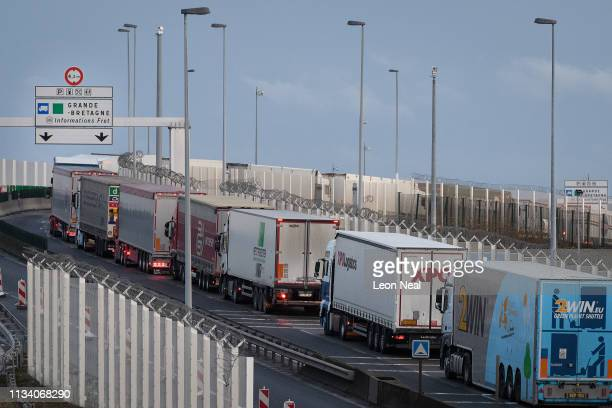 Line of trucks snakes along an access road leading towards the port of Calais on March 06, 2019 in Calais, France. Delays have increased as customs...