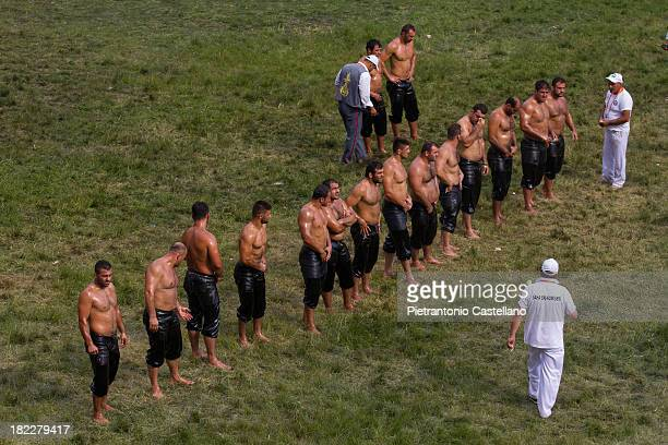 """Line of Turkish Oil wrestlers ready to enter the arena to fight in the annual contest known as """"Kirkpinar"""", in Edirne, Turkey."""