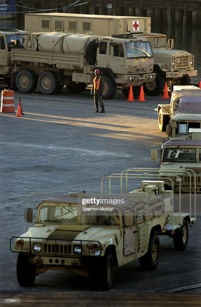A line of U S  Army Humvees waits on a dock January 14, 2003 at the