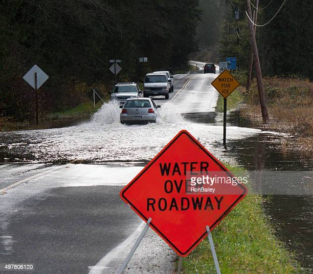 Line of Vehicles Crossing Flooded Carnation Farm Road