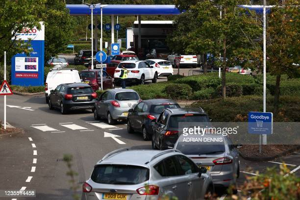 Line of vehicles queue to fill up at a Tesco petrol station in Camberley, west of London on September 26, 2021. - Britain's transport secretary Grant...