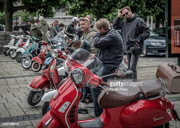 Line of Vespas during Mods vs Rockers an event with motorcycles and Vespas mostly from the 1950s and early 60s Event created by mods and rockers in...