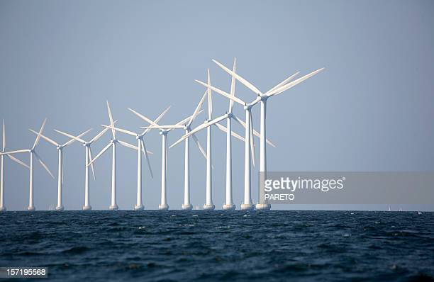 A line of wind turbines at an off-shore wind farm