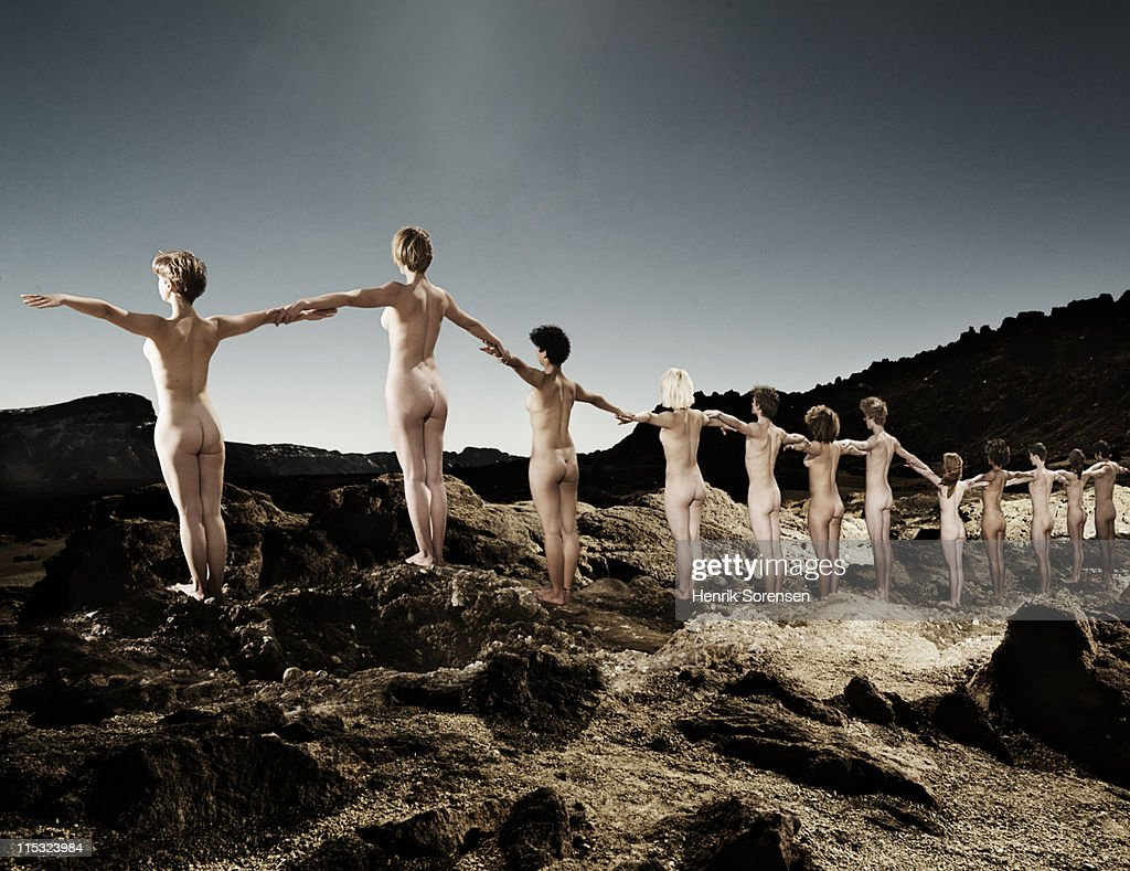 line of young naked people in the mountains : Stock Photo