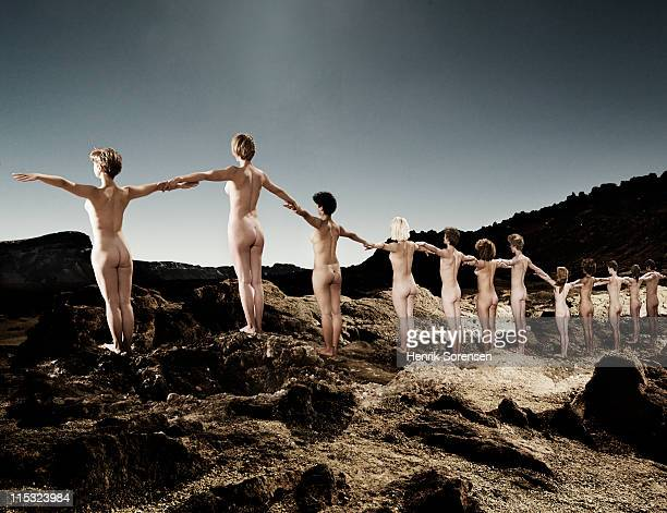 line of young naked people in the mountains