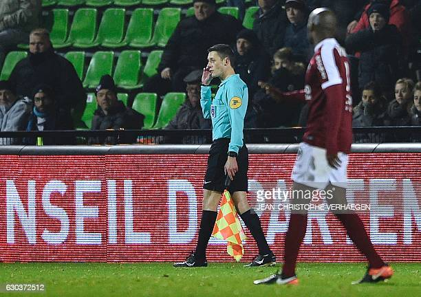 Line referee Gilles Lang walks during the French L1 football match between Metz and Guingamp on December 21 at the Saint Symphorien stadium in...
