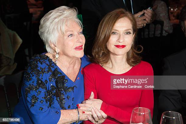 Line Renaud and Isabelle Huppert attend the Sidaction Gala Dinner 2017 as part of Paris Fashion Week on January 26 2017 in Paris France