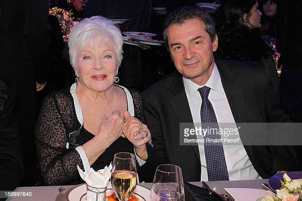 Line Renaud and professor Yves Levy attend the Sidaction Gala Dinner 2013 at Pavillon d'Armenonville on January 24 2013 in Paris France