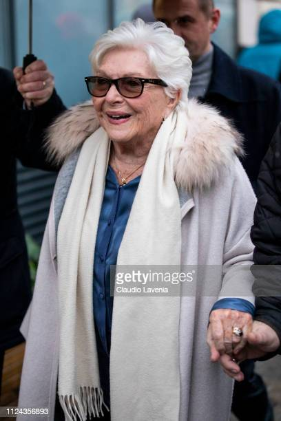 Line Renaud wearing a blue silky shirt cream coat with fur details and cream scarf is seen outside Jean Paul Gaultier show during Paris Fashion Week...