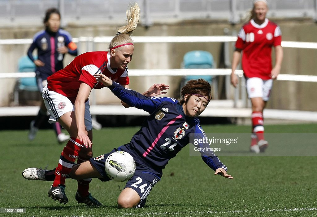 Line Roddik Hansen (L) of Denmark challenges Asano Nagasato of Japan during the Algarve Cup 2013 match between Denmark and Japan at the Algarve stadium on March 11, 2013 in Faro, Portugal.