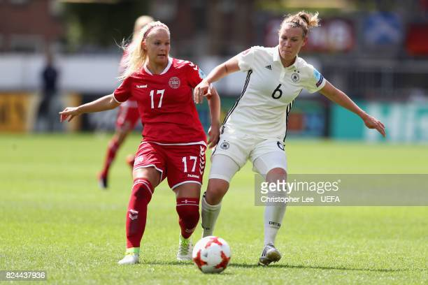 Line Sigvardsen Jensen of Denmark and Kristin Demann of Germany battle for possession during the UEFA Women's Euro 2017 Quarter Final match between...