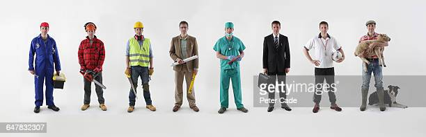 line up of different occupations - white pants stock pictures, royalty-free photos & images