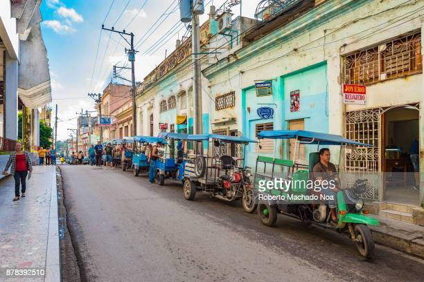 A line up of 'motonetas' by the 'Coppelia' The mode of transport is popular and affordable in urban areas Areas for line up are designated by the...
